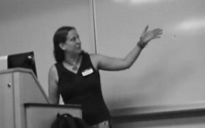 Dawn waves her hand around impressively while presenting at the New York Tolkien Conference